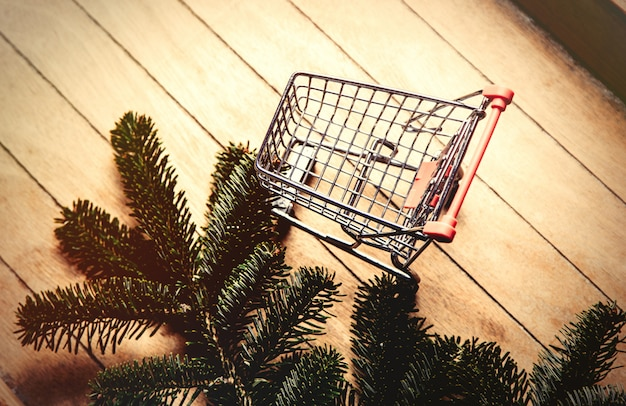 Pine tree branch and shopping cart