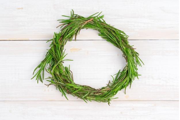 Pine tree wreath on wooden background