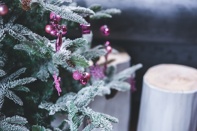 Pine with snowy leaves and candles