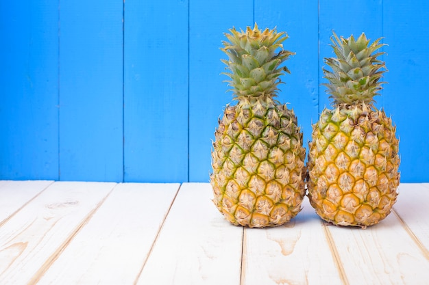 Pineapple on blue wooden backdrop