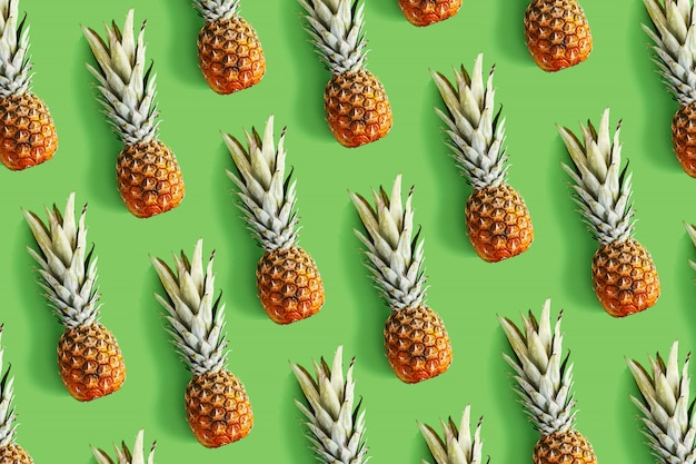 Pineapple on bright background creative layout