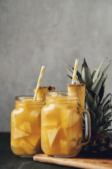 Pineapple cocktail with straw. tropical drink