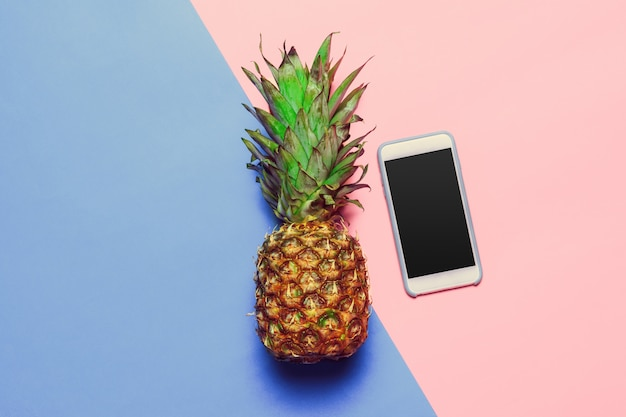 Pineapple on colored paper background