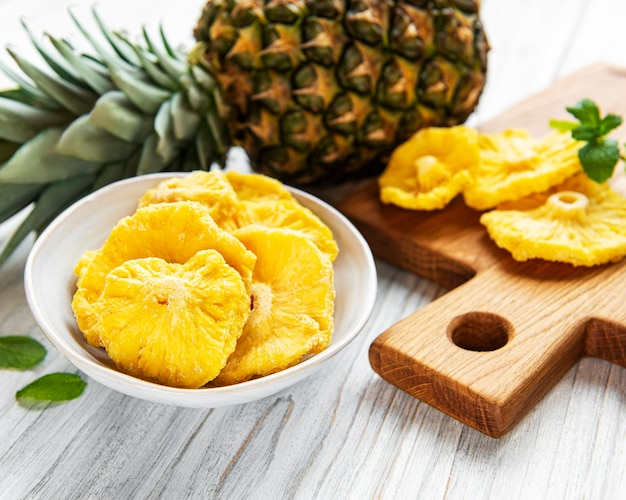 Pineapple dried rings on rustic wooden surface