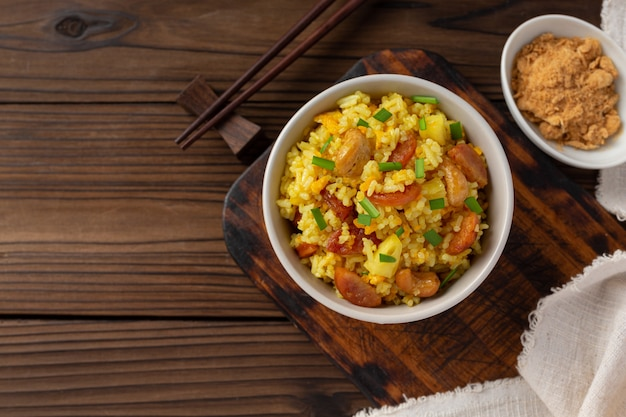 Pineapple fried rice on wooden table