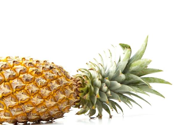 Pineapple fruit against white background