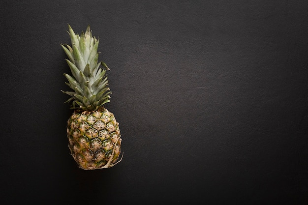 Pineapple fruit isolated on black