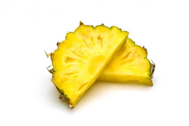 Pineapple fruit sliced on white surface