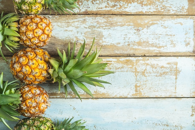 Pineapple fruit on a wooden background