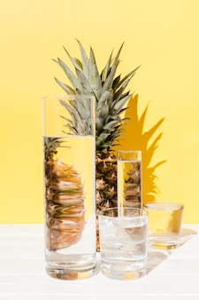Pineapple and glasses arrangement