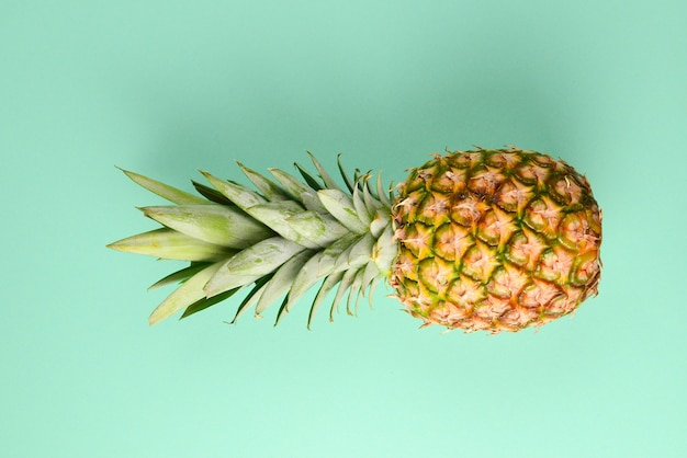 Pineapple on a green background