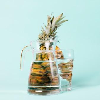 Pineapple behind a jug of water