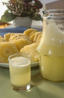 Pineapple. juice and cut fruit set on the table.