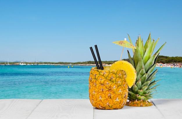 Pineapple juice served in the peel