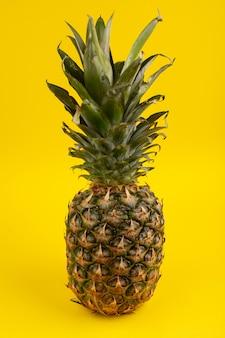 Pineapple juicy tasty mellow on a yellow floor