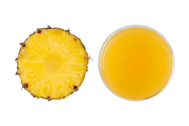 Pineapple mix of tropical citrus fruit and juice in glass.