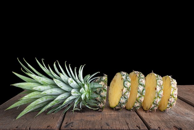 Pineapple on old wooden table