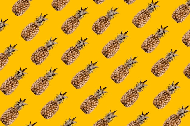 Pineapple pattern mix of tropical citrus fruits on yellow background.