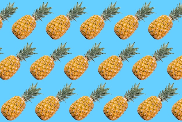 Pineapple pattern with blue background and minimalist style pop art design with a creative flair Premium Photo