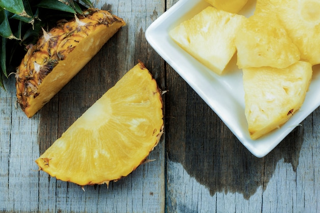 Pineapple of slices on wooden.