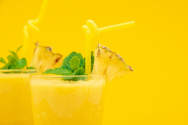 Pineapple smoothie drinks in the glasses