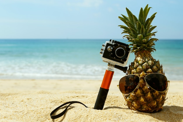 Pineapple, sunglasses and action-cam