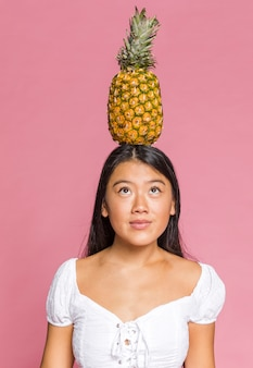 Pineapple on top of a woman head