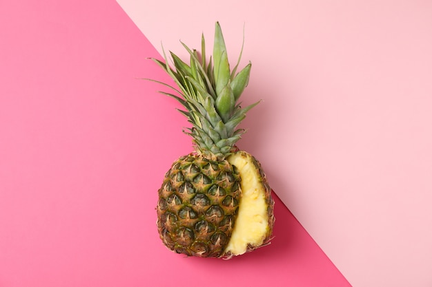 Pineapple on two tone background, space for text