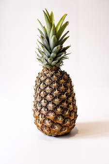 Pineapple on a white background, ripe pineapple on a white background, juicy pineapple on a white background.