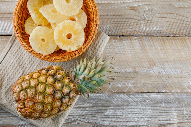 Pineapple with candied rings on kitchen towel