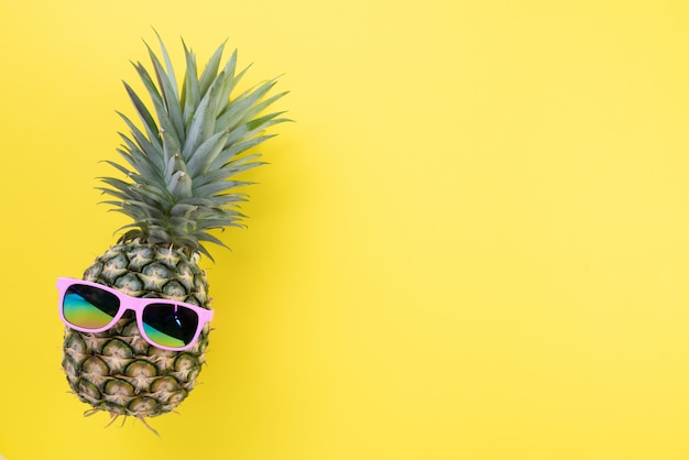 Pineapple with pink sunglasses for summer holiday and vacation concept.