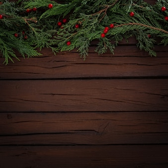 Pines christmas composition on a wooden background with copy space