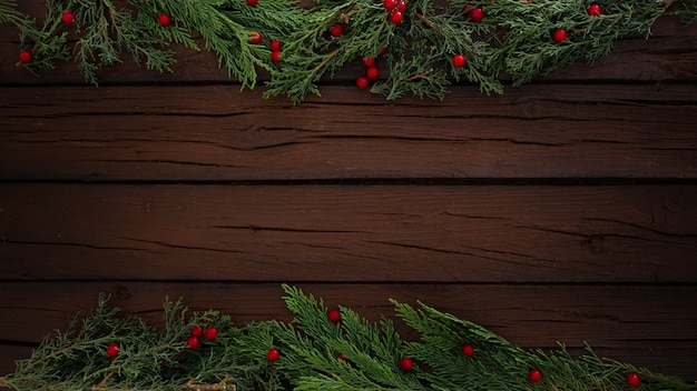 Pines christmas composition on a wooden frame background with copy space