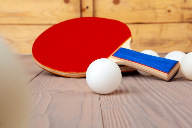 Ping pong equipment on wooden table close up