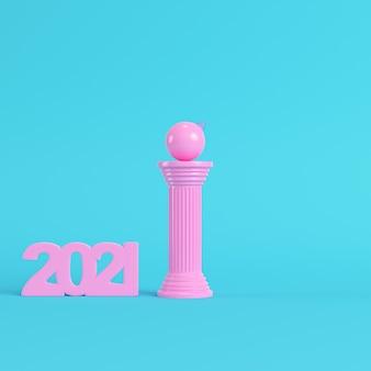 明るい青色の背景の古代の列にクリスマスボールとピンクの2021年の数字