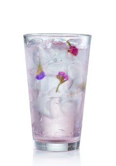 Pink alcohol cocktail with rose flower bud isolated