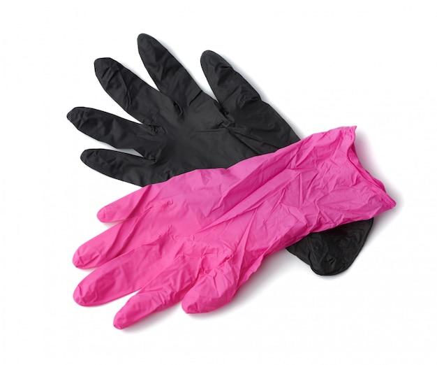 白い背景に分離されたピンクと黒のラテックス手袋