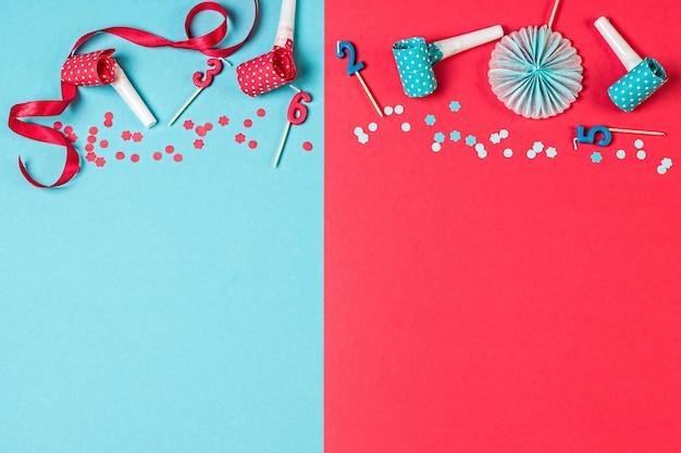 Розовый и синий праздничный фон со свечами, конфетти и другими праздничными аксессуарами