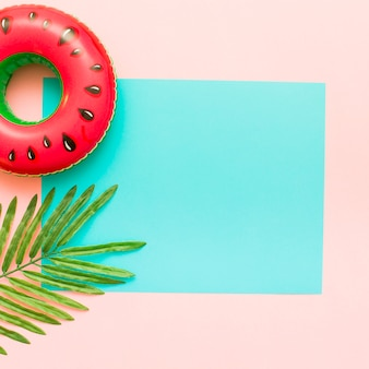Pink and blue pastel background with tropical leaves