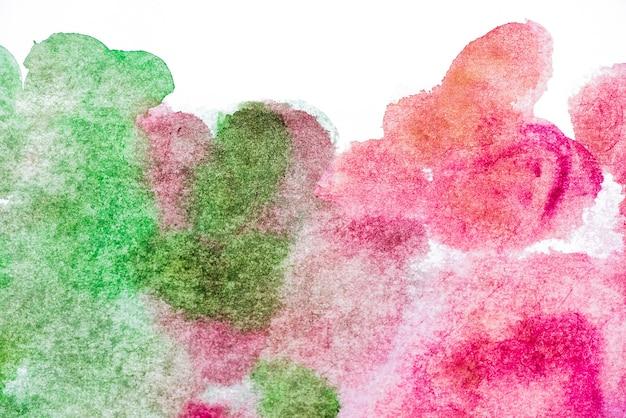 ピンクと緑の水彩模様の背景