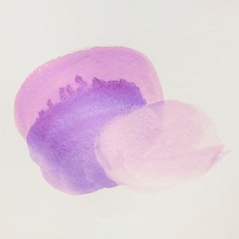 白いキャンバスの背景にピンクと紫の手描きの塊