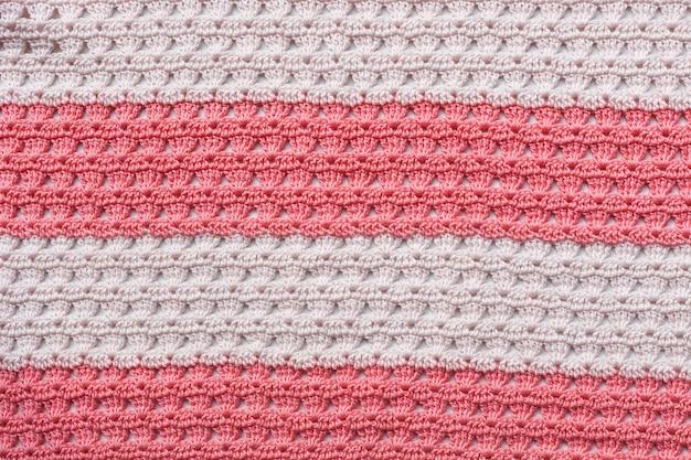 ピンクと白のニット編みパターン、柄。