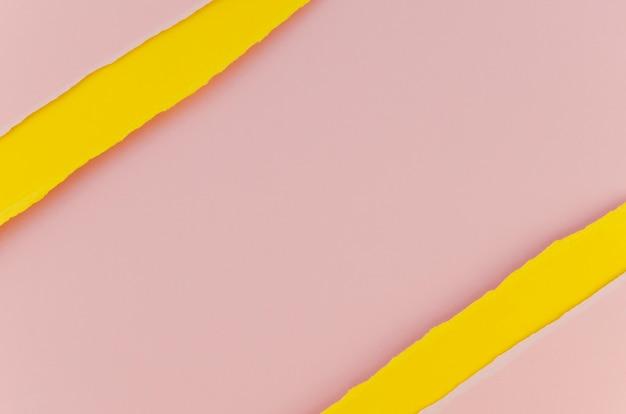 ピンクと黄色の破れた紙