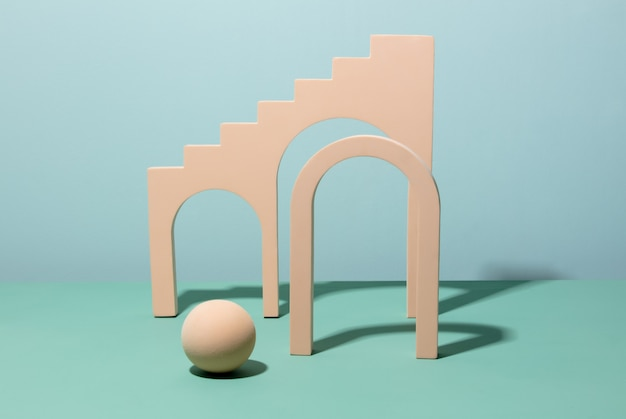 Pink arch and sphere on blue background