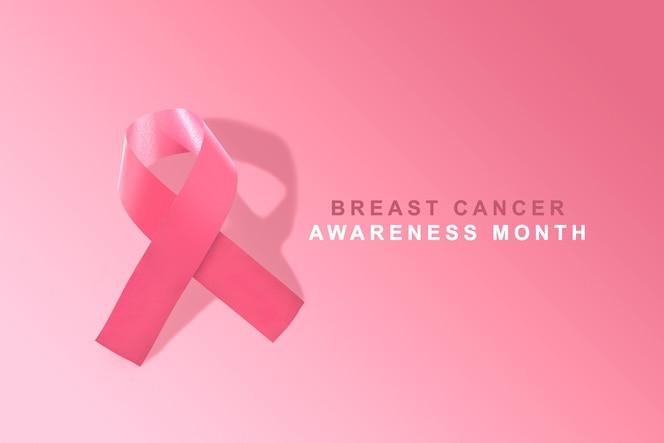 ピンクの背景にピンクのアウェアネスリボン。乳がんの意識