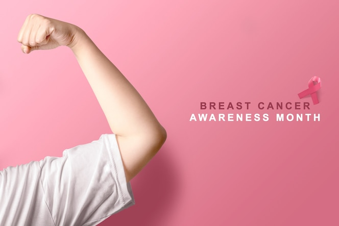 Pink awareness ribbon on pink background. breast cancer awareness