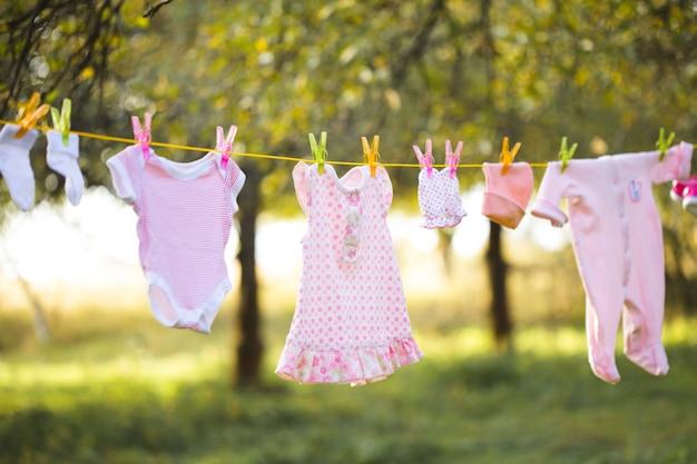 Pink baby wear outdoor in the garden