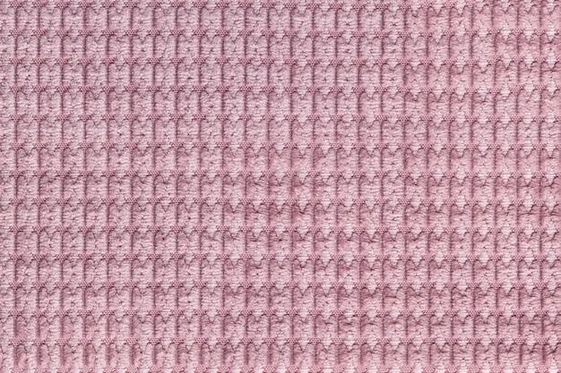 柔らかいフリース生地からピンクの背景をクローズアップ。テキスタイルマクロのテクスチャ