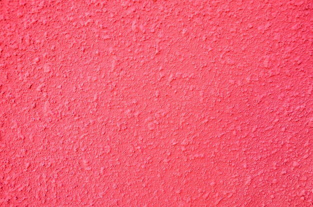 ピンクの背景背景としての漆喰壁の一部