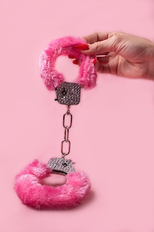 On a pink background sex product, a toy for adults